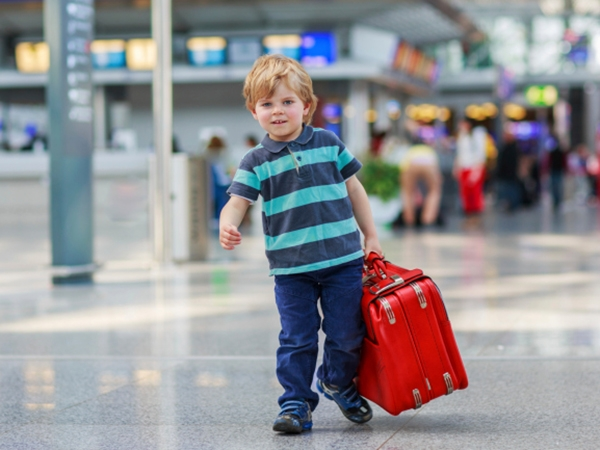 Special Needs Travel: 6 Essentials for Long-Haul Flights ...  Little Boy Traveling